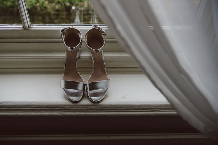 A photo of a pair of brides wedding shoes