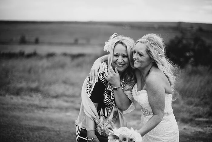 Bride and friend smiling together after the wedding