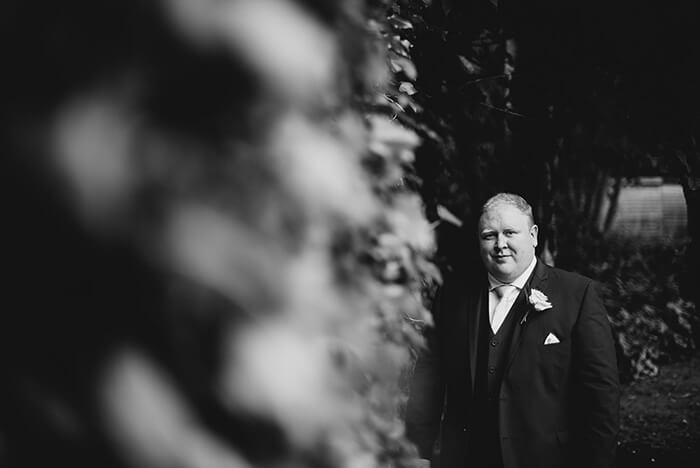 A black and white photo of a groom